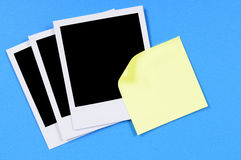 Blank polaroid frame photo prints with yellow sticky note  Stock Photography