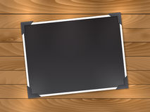 Blank photo on wood background Stock Image
