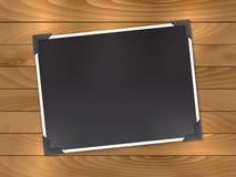 Blank photo on wood background Stock Image