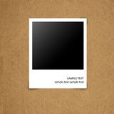 Blank photograph on grunge paper board. Background Royalty Free Stock Image