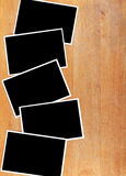 Blank photograph paper on wooden desk Royalty Free Stock Image