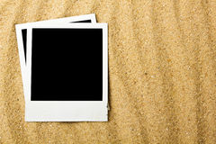 Blank photographs on beach Stock Image