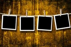 Blank photographs hanging Stock Photo