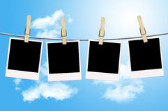Blank photographs hanging on clothesline Royalty Free Stock Photos
