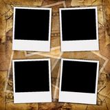 Blank photos. Four blank photos on a grungy background Royalty Free Stock Photo