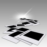 Blank photos. Falling blank photos and flash light camera Stock Photography