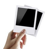 Blank photos. Man hand hold blank photos Royalty Free Stock Photo