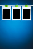 Blank photos on blue background Royalty Free Stock Photos