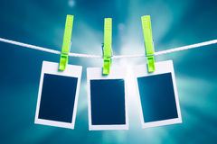 Blank photos on blue lights background Royalty Free Stock Images