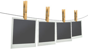 Blank photos on clothesline, isolated white background Royalty Free Stock Photos