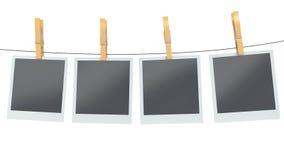 Blank photos on clothesline, isolated white background Stock Images