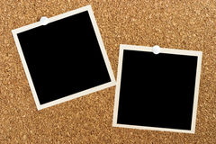 Blank photos on cork board. Two blank photos posted on cork board Stock Image