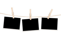 Blank photos hanging on clothesline Stock Photography