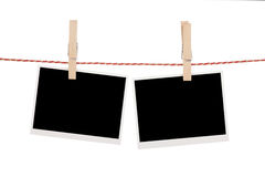 Blank photos hanging on clothesline Stock Images