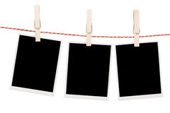 Blank photos hanging on clothesline Stock Image