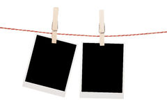 Blank photos hanging on clothesline Royalty Free Stock Photos