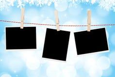 Blank photos hanging on clothesline Stock Photos