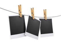 Blank photos hanging on rope Stock Image
