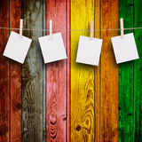 Blank Photos. On Multicolored Wood Background Royalty Free Stock Photography
