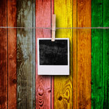 Blank Photos. On Multicolored Wood Background Stock Photography
