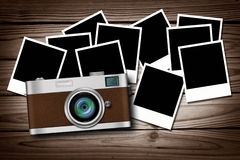 Blank photos on old wood with classic camera Stock Photos