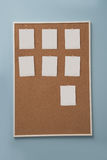 Blank photos pined on cork board Royalty Free Stock Photo
