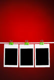 Blank photos on red background Royalty Free Stock Image