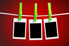 Blank photos on red background Royalty Free Stock Photography