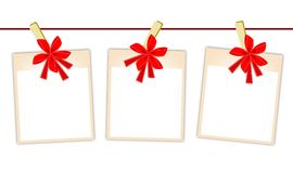 Blank Photos with Red Ribbon Hanging on Clothesline Royalty Free Stock Images