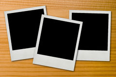 Blank photos on wood Royalty Free Stock Image