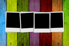 Blank Photos on Wood Background. Four blank photos on a multicolored wood background Royalty Free Stock Photography