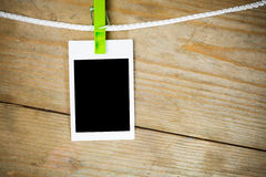 Blank photos on wooden background Stock Images