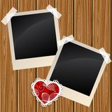 Blank photos on a wooden wall. Blank instant photo frames on a wooden wall Royalty Free Stock Photography