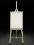 Blank picture. Wooden easel with blank framed picture on black background. 3D render Stock Image