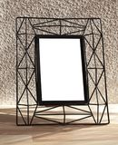 Blank picture frame at the brick wall with copy space. royalty free stock image