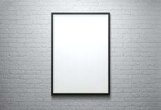 Blank picture frame. At the brick wall with copy space and clipping path for the inside Stock Images