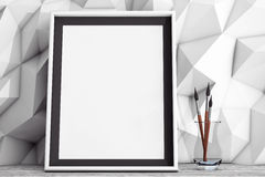 Blank Picture Frame with Brushes in front of Low Polygon Decorat Stock Image