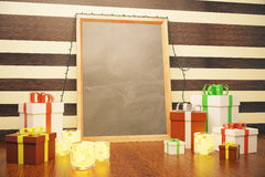 Blank picture frame with christmas gift boxes and lit candles Royalty Free Stock Photo