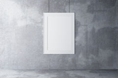 Blank picture frame on a concrete wall and concrete floor Royalty Free Stock Image