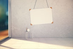 Blank picture frame on concrete wall in empty room at evening, Stock Images