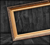 Blank Picture Frame in Dark Room Royalty Free Stock Photo