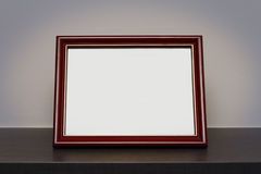 Blank picture frame at the desk Royalty Free Stock Photos