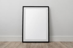 Blank picture frame. On the floor with clipping path Stock Photo