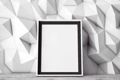Blank Picture Frame in front of Low Polygon Decorative Wall. 3d Stock Photo