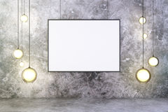Blank picture frame with lightbulbs and concrete wall and floor, Royalty Free Stock Image