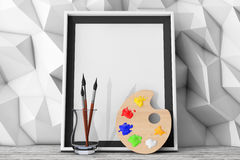 Blank Picture Frame with Paintbrushes and Pallette in front of L Royalty Free Stock Photography