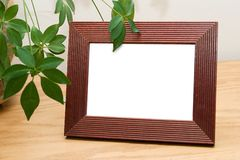 Blank picture frame ready for custom image to be added. Blank reddish brown picture frame royalty free stock image