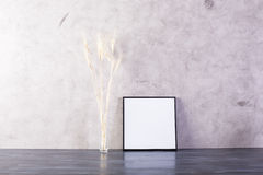 Blank picture frame. Small picture frame and wheat spikes on concrete background. Mock up Royalty Free Stock Photos