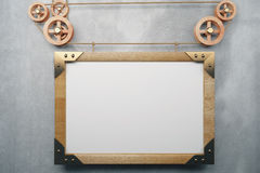 Blank picture frame in the style of steampunk hanging on concret Royalty Free Stock Images