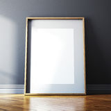 Blank picture frame and sunlight. On a wall Royalty Free Stock Image